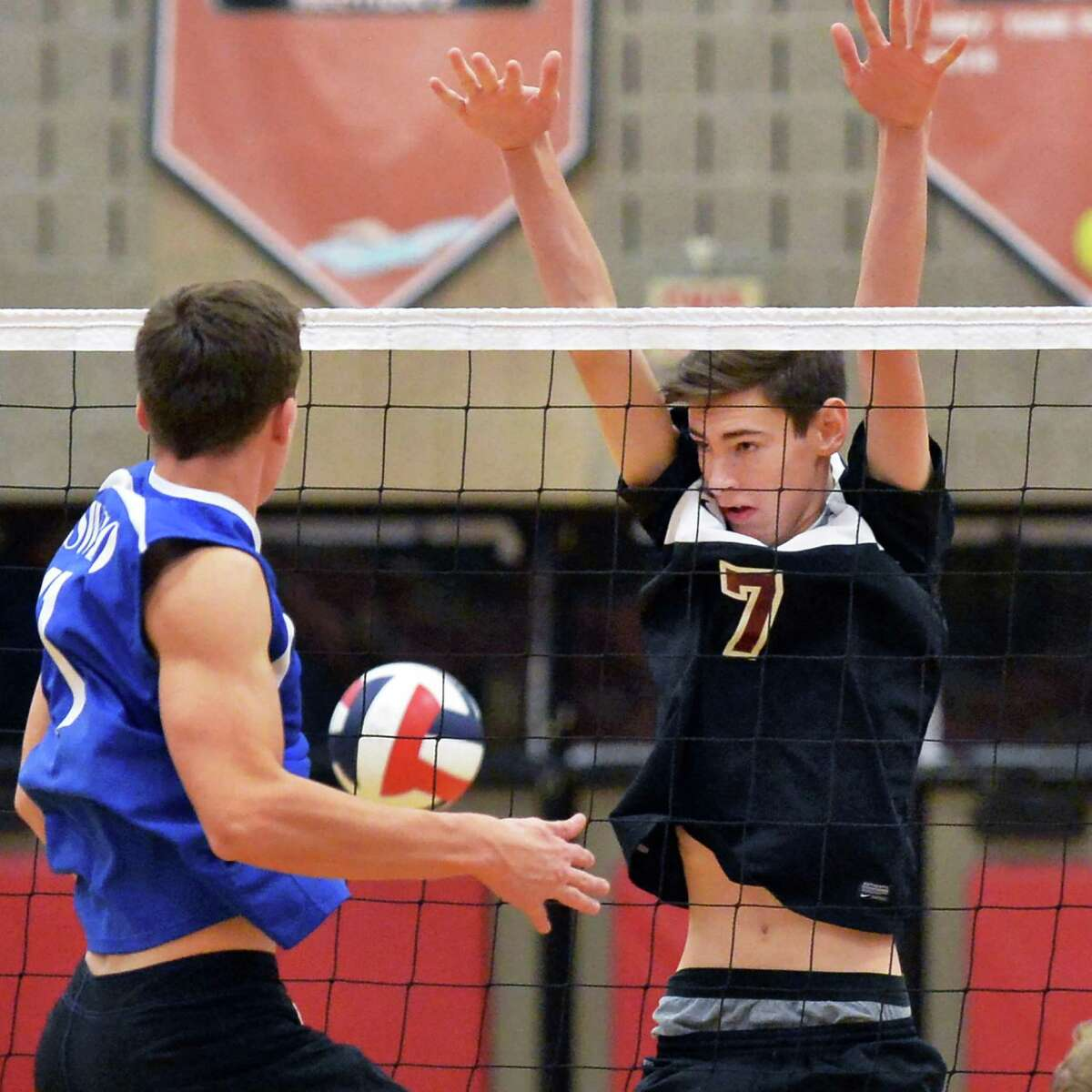 Oswego's #11 Jake Caster, left, and Burnt Hills's #7 Matt Hagan during Saturday's volleyball regional final against Nov. 14, 2015 in Guilderland, NY. (John Carl D'Annibale / Times Union)