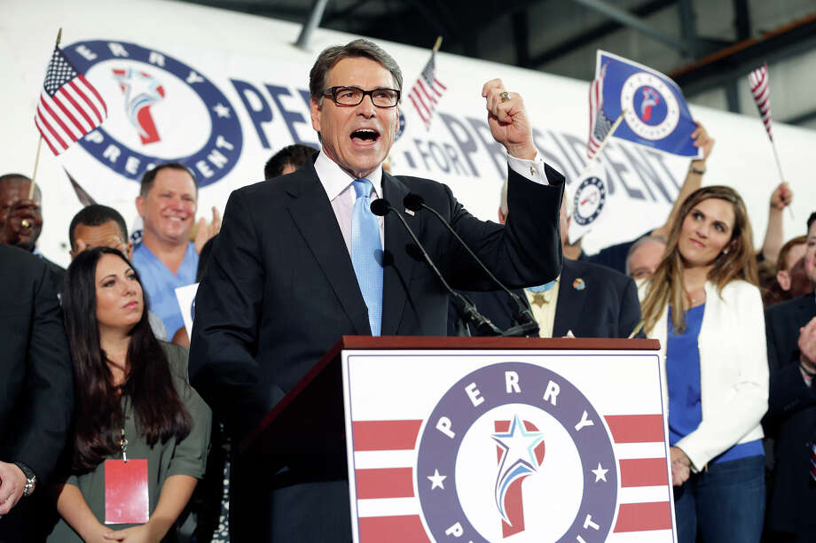 Former Texas Governor Rick Perry announces his candidacy  for President of the United States at the Million Air hanger at the Addison airport near Dallas on June 4,, 2015. At right is Kaya Kyle, widow of Chris Kyle, whose military career was chronicled in American Sniper. Photo: Tom Reel, Staff / San Antonio Express-News / San Antonio Express-News