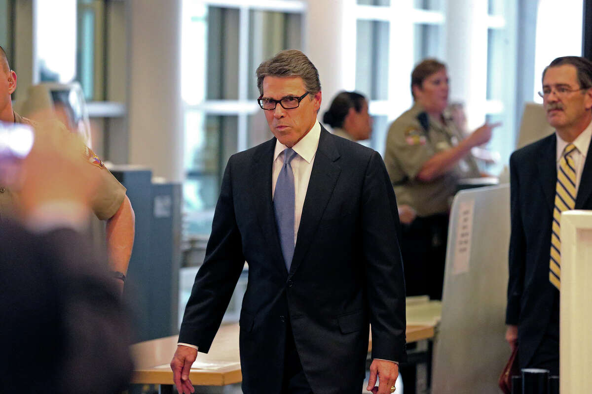 Texas Governor Rick Perry goes through the process of being booked for felony charges at the Travis County Courthouse in Austin on August 20, 2014. Perry used $2.65 million of campaign cash for legal defense in the case, which was dismissed by Texas' highest criminal court earlier this year.