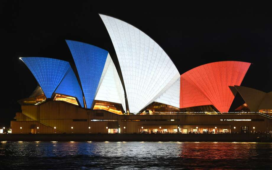 The iconic sails of the Sydney Opera House are lit in red, white and blue, resembling the colours of the French flag, in Sydney on November 14, 2015, as Australians express their solidarity with France following a spate of coordinated attacks that left 128 dead and 180 injured in Paris late on November 13. Both the Opera House and the Sydney Town Hall were bathed in the French colours and New South Wales state Premier Mike Baird said he had also asked for a French flag to fly over the city's famous harbour bridge.  Photo: William West, AFP / Getty Images