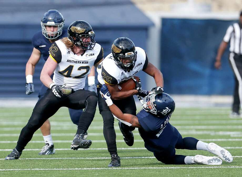 Rice's Ryan Pollard has a hard time bringing down Southern Miss' Ito Smith. Photo: Karen Warren, Staff / © 2015 Houston Chronicle
