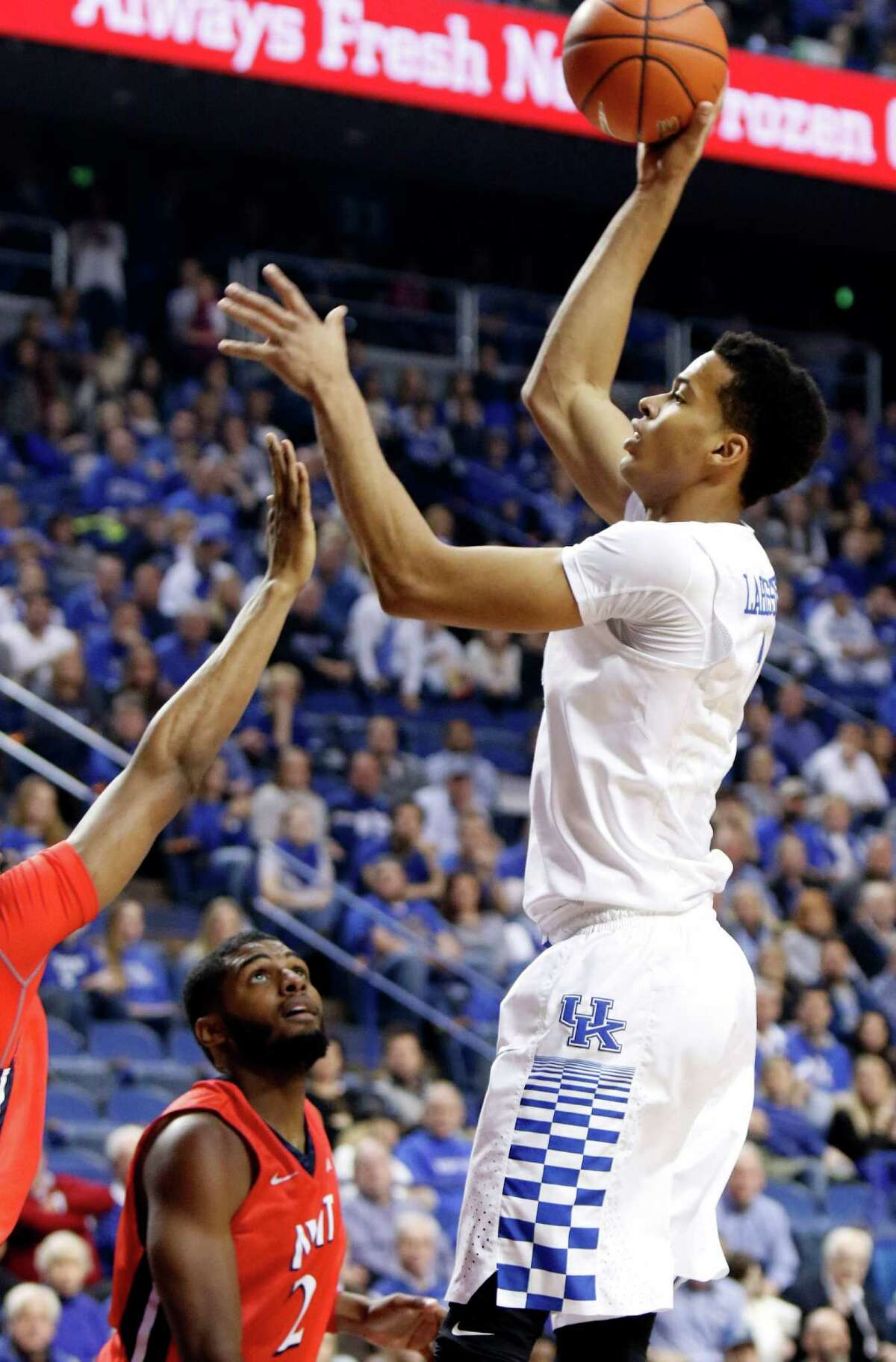 Kentucky's Skal Labissiere, right, shoots over NJIT's Terrence Smith, partially in frame at left, and Tim Coleman (2) during the first half of an NCAA college basketball game Saturday, Nov. 14, 2015, in Lexington, Ky. (AP Photo/James Crisp) ORG XMIT: KYJC102