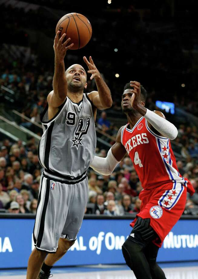 Spurs' Tony Parker (09) drives to the basket against the Philadelphia 76ers Nerlens Noel (04) at the AT&T Center on Saturday, Nov. 14, 2015. Photo: Kin Man Hui, San Antonio Express-News / ©2015 San Antonio Express-News