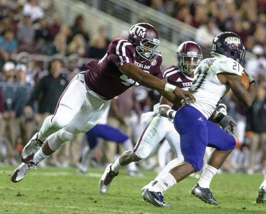 Texas A&M's Jarrett Johnson, left, puts pressure on Western Carolina's Detrez Newsome (21) during the first half of an NCAA college football game Saturday, Nov. 14, 2015, in College Station, Texas. (AP Photo/Juan DeLeon) Photo: Juan DeLeon, FRE / Associated Press / FR171058 AP