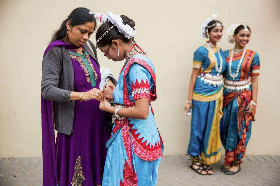 Rina Sadhukhan helps her daughter Maumita Sadhukhan get ready to perform during the Diwali festival. Photo: Carolyn Van Houten /Carolyn Van Houten / 2015 San Antonio Express-News