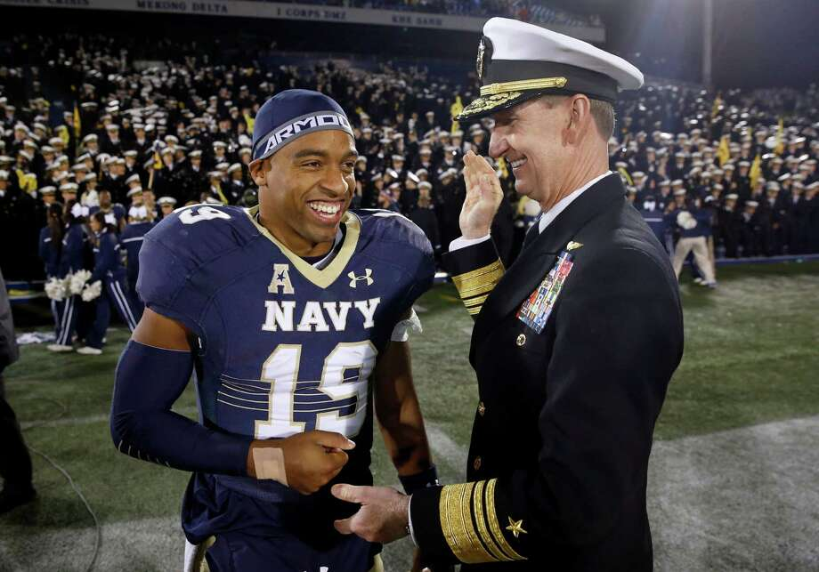 Navy quarterback Keenan Reynolds, left, is congratulated by U.S. Naval Academy superintendent Ted Carter, Jr., after an NCAA college football game, Saturday, Nov. 14, 2015, in Annapolis, Md. Reynolds broke the NCAA all-time record for rushing touchdowns during the game and Navy won 55-14. (AP Photo/Patrick Semansky) Photo: Patrick Semansky, STF / AP