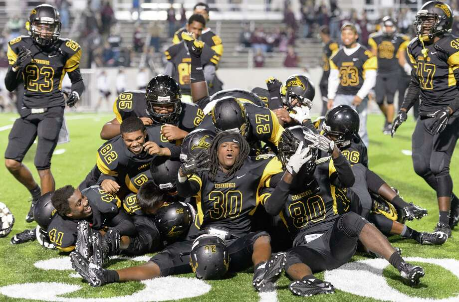 After Eisenhower rallies for its first playoff win in eight years Saturday, the Eagles come together in a pile of jubilation at Thorne Stadium. Photo: Wilf Thorne / © 2015 Houston Chronicle