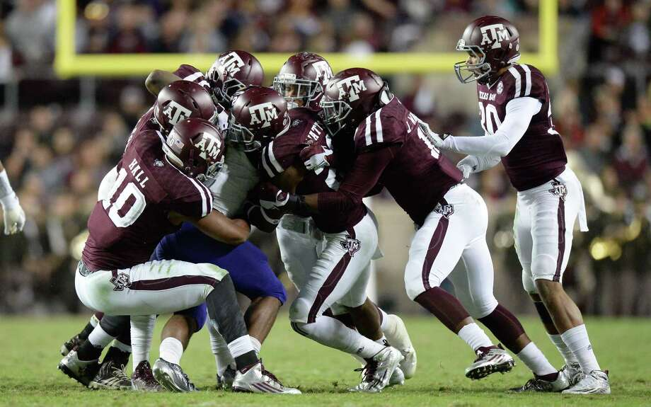 Western Carolina's Detrez Newsome (21) is meet at the line by the Texas A&M defense during a NCAA college football game in College Station, Texas, Saturday, Nov. 7, 2015.  (Sam Craft/College Station Eagle via AP) MANDATORY CREDIT Photo: Sam Craft, MBR / College Station Eagle