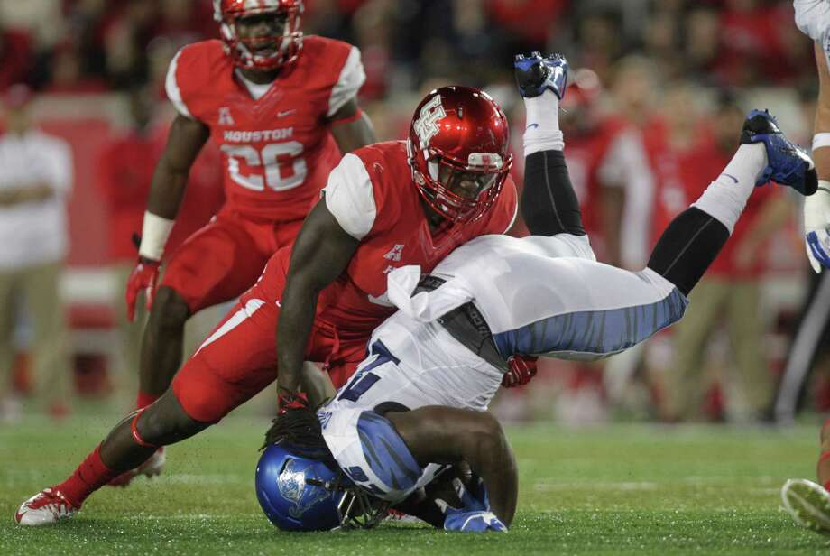 Houston Cougars safety Adrian McDonald (16) hits Memphis Tigers wide receiver Frank Wims (35) during the first quarter of an AAC football game at TDECU Stadium Saturday, Nov. 14, 2015, in Houston.  ( Jon Shapley / Houston Chronicle ) Photo: Jon Shapley, Staff / © 2015 Houston Chronicle