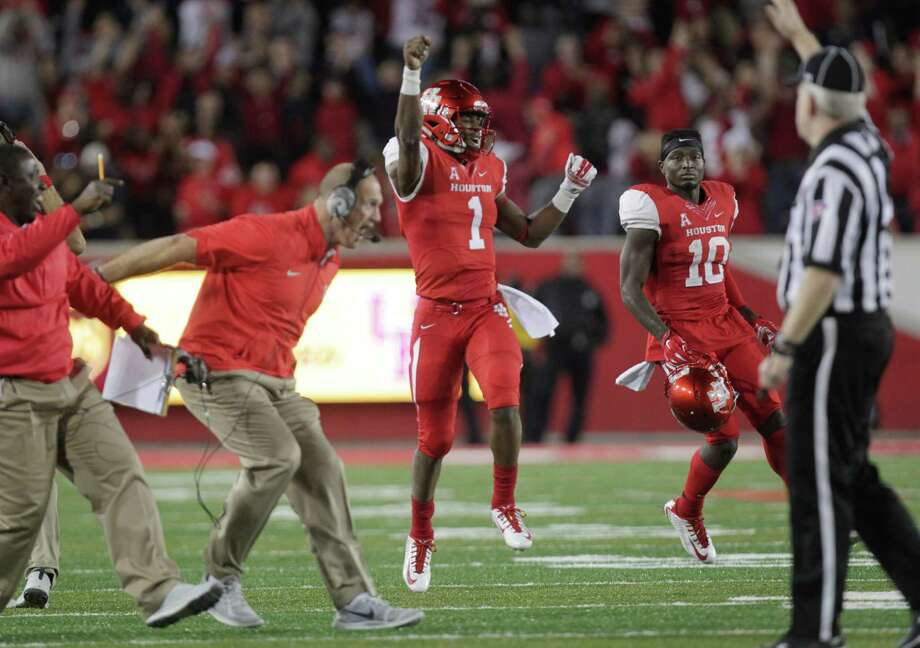 UH's Greg Ward Jr., right, had enough spring in his step to celebrate Memphis' missed field goal in the final minute. Photo: Jon Shapley, Staff / © 2015 Houston Chronicle