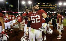 Stanford players, lincluding Graham Shuler, 52 leave the field as Oregon won 38-36 at Stanford Stadium on Sat. November 14, 2015 in Stanford, Calif.