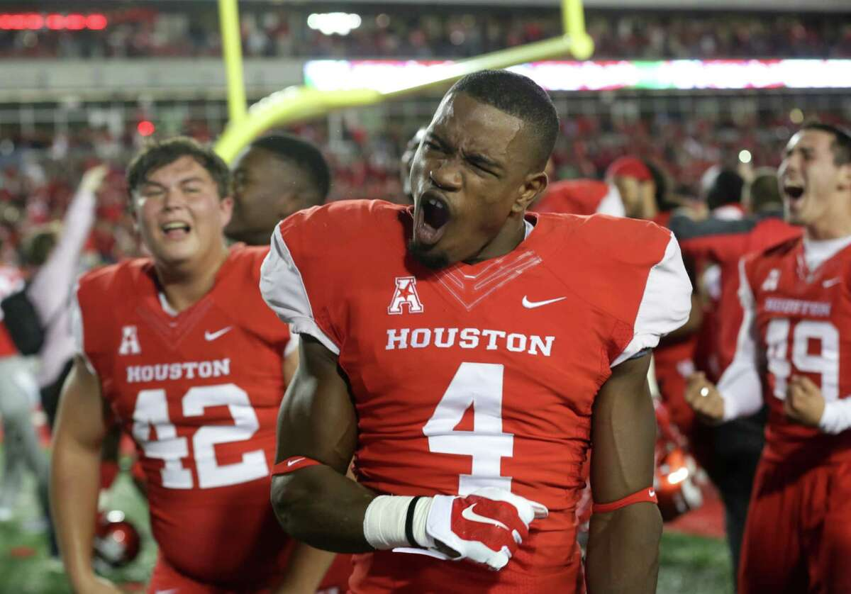 Houston Cougars cornerback Tyler White (4) celebrates after the Cougars defeated the Memphis Tigers at TDECU Stadium Saturday, Nov. 14, 2015, in Houston.