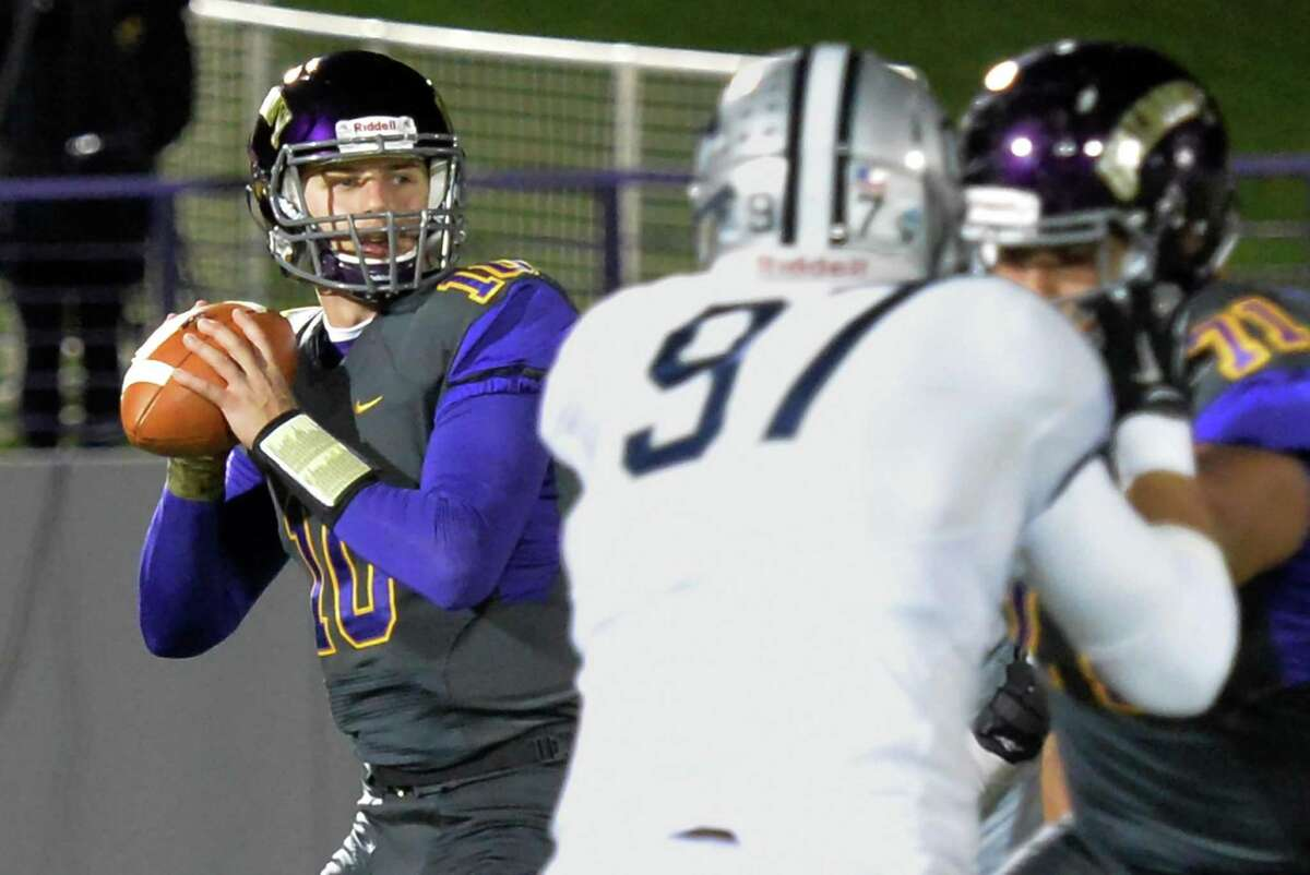 UAlbany QB #10 Nevin Sussman readies to throw a completion to wide receiver Brad Harris during Saturday's game ageinst UNH at Casey Stadium Nov. 14, 2015 in Albany, NY. (John Carl D'Annibale / Times Union)