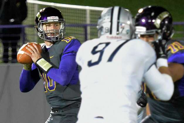 UAlbany QB #10 Nevin Sussman readies to throw a completion to wide receiver Brad Harris during Saturday's game ageinst UNH at Casey Stadium Nov. 14, 2015 in Albany, NY.  (John Carl D'Annibale / Times Union) Photo: John Carl D'Annibale / 00034184A