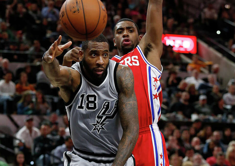 Spurs' Rasual Butler (18) passes the ball against the Philadelphia 76ers' Hollis Thompson at the AT&T Center on Nov. 14, 2015. Spurs defeated the Sixers, 92-83. Photo: Kin Man Hui /San Antonio Express-News / ©2015 San Antonio Express-News