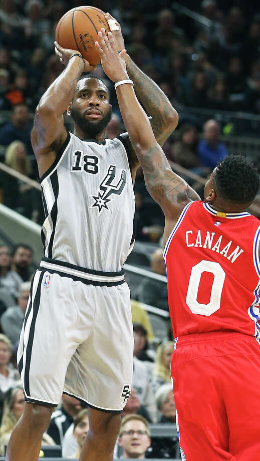 Spurs' Rasual Butler puts up a jumper against the 76ers' Isaiah Canaan at the AT&T Center on Nov. 14, 2015. Photo: Tom Reel /San Antonio Express-News / 2015 SAN ANTONIO EXPRESS-NEWS