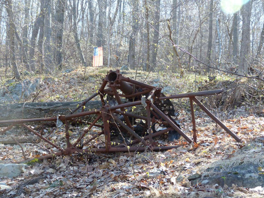 This May 1, 2015 photo provided by David Rocco shows some of the wreckage from 1945 of the twin-engine Navy Beechcraft that crashed into Mount Beacon in Fishkill, N.Y. (David Rocco via AP) Photo: David Rocco, HONS / Associated Press / David Rocco