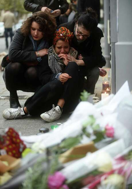A woman cries near Le Petit Cambodge restaurant the day after the attacks in Paris. Photo: Antoine Antoniol / Getty Images / 2015 Getty Images