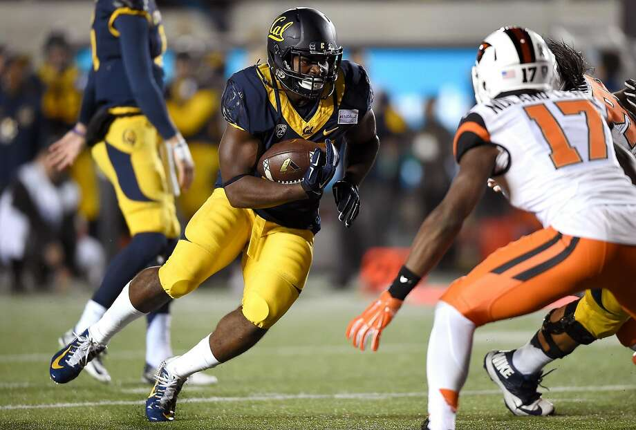 BERKELEY, CA - NOVEMBER 14:  Vic Enwere #23 of the California Golden Bears rushes for a one yard touchdown run against the Oregon State Beavers in the second quarter of their NCAA football game at California Memorial Stadium on November 14, 2015 in Berkeley, California.  (Photo by Thearon W. Henderson/Getty Images) Photo: Thearon W. Henderson, Getty Images