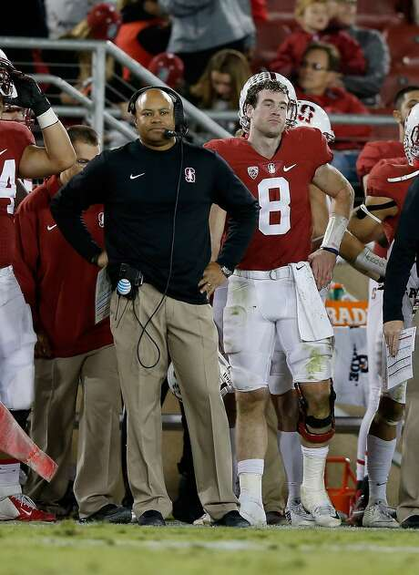 Coach David Shaw and quarterback Kevin Hogan see playoff hopes evaporate. Photo: Ezra Shaw, Getty Images