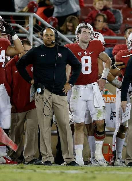 Coach David Shaw and quarterback Kevin Hogan see playoff hopes evaporate. Photo: Ezra Shaw, Getty Images