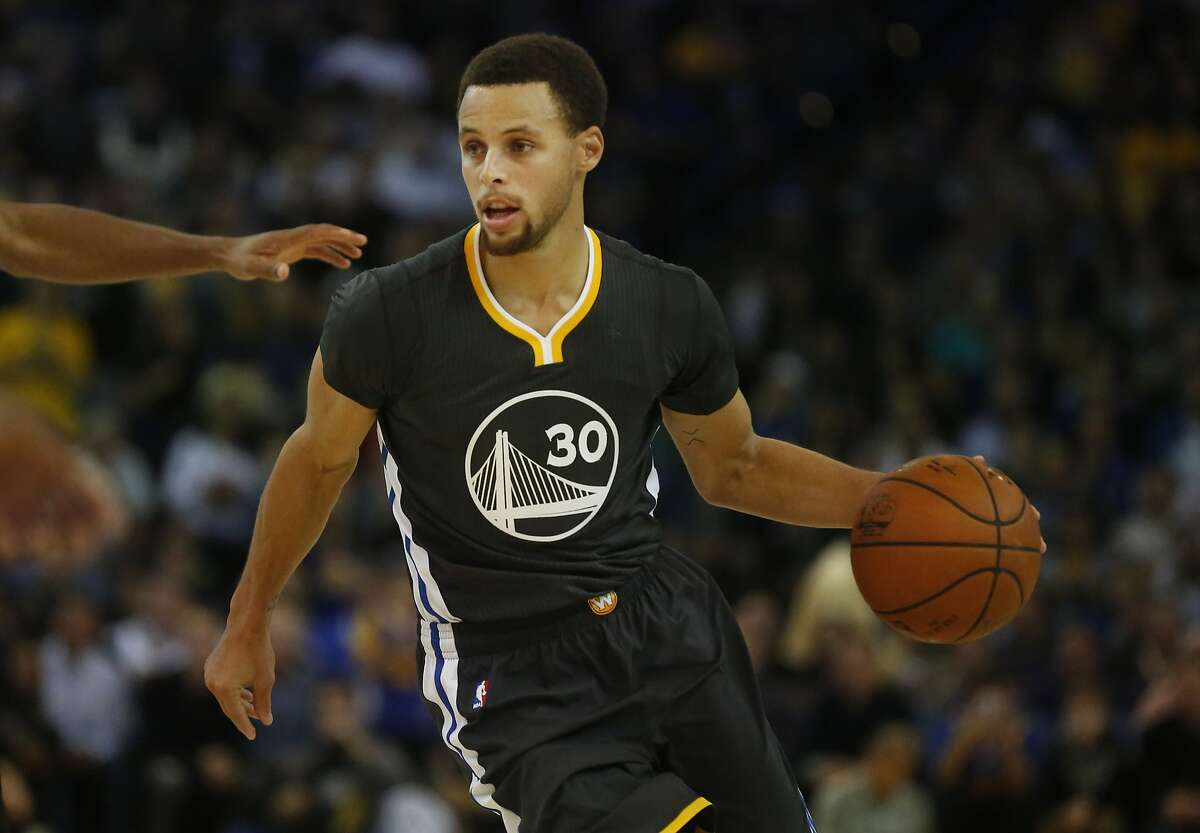 Stephen Curry drives the ball towards the basket during the Golden State Warriors vs. the Brooklyn Nets game in the Oracle Arena Nov. 14, 2015 in Oakland, Calif. The Warriors won 107-99 in overtime.