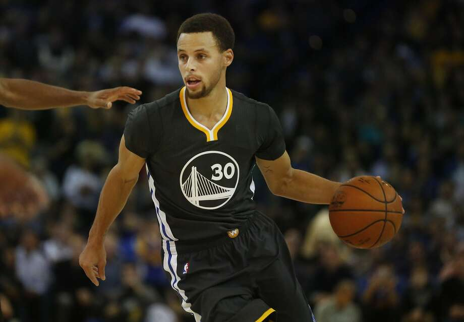 Stephen Curry drives the ball towards the basket during the Golden State Warriors vs. the Brooklyn Nets game in the Oracle Arena Nov. 14, 2015 in Oakland, Calif. The Warriors won 107-99 in overtime. Photo: Leah Millis, The Chronicle