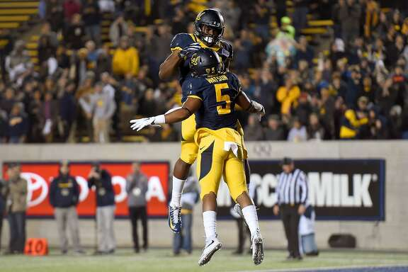 BERKELEY, CA - NOVEMBER 14:  Tre Watson #5 and Vic Enwere #23 of the California Golden Bears celebrates after Watson scored on a 45-yard touched down pass play against the Oregon State Beavers in the second quarter of their game at California Memorial Stadium on November 14, 2015 in Berkeley, California.  (Photo by Thearon W. Henderson/Getty Images)