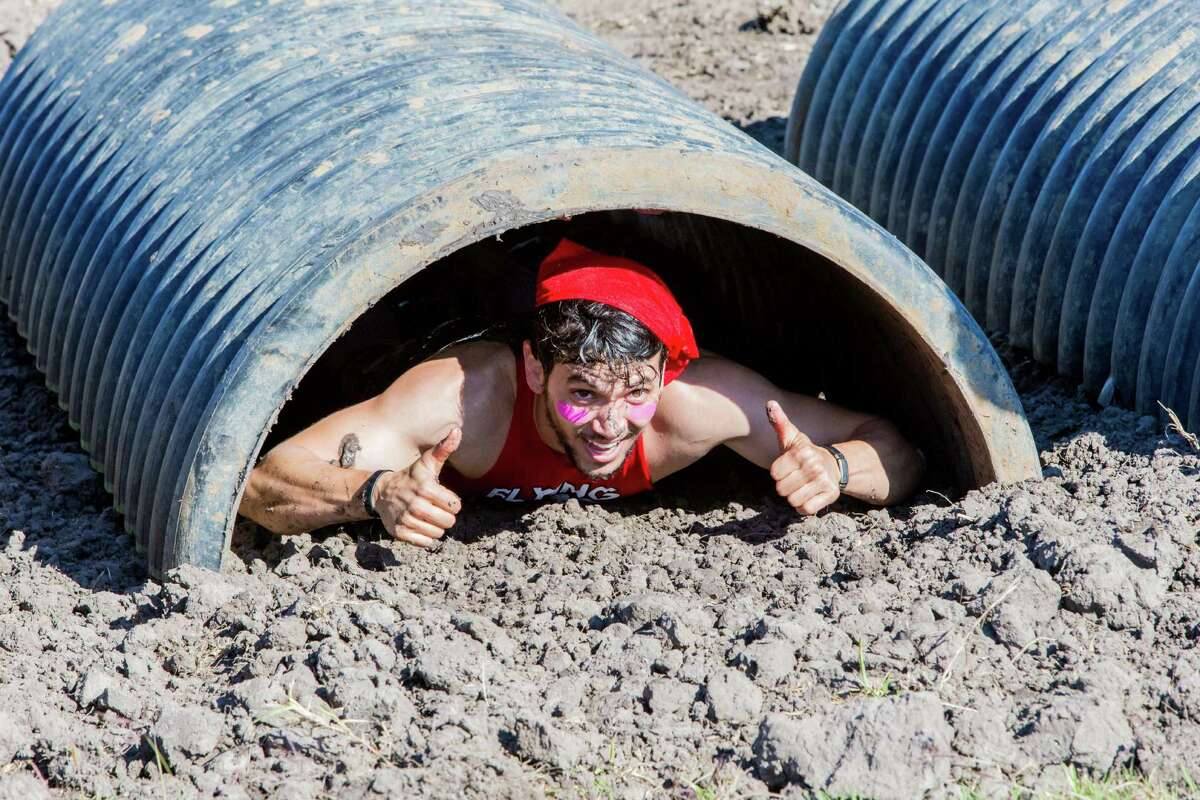 A muckers reacting after completing one of the last obstacles during the MuckFest at Royal Purple Raceway, Saturday, Nov. 14, 2015, in Baytown.