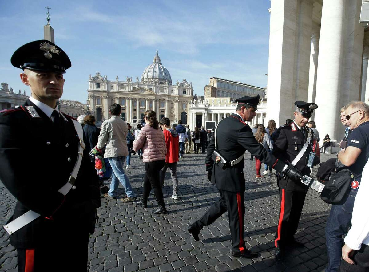 Carabinieri officers perform security checks in St. Peter's Square at the Vatican, Sunday, Nov. 15, 2015. Italy's top security official said Italy has heightened security inside Italy and along its borders, especially with France, following the attacks in Paris. Interior Minister Angelino Alfano said Saturday that 700 soldiers were being deployed immediately to Rome as a deterrent and additional security measures will be taken into consideration for the upcoming Jubilee year declared by Pope Francis that is expected to bring millions to Rome beginning Dec. 8.