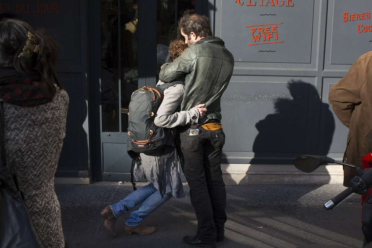 People hug on Sunday in Paris, two days after terror attacks that killed and injured people at several sites across the city, Nov. 15, 2015.