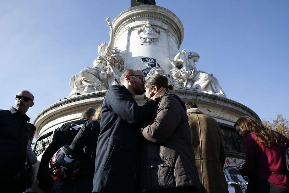 Amidst the tragedy in Paris, there were also beautiful acts of kindness. Here are six of those many small shows of love and selflessness. Photo: Patrick Kovarik, AFP / Getty Images
