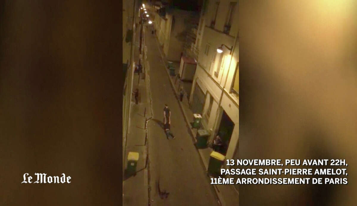 This Friday, Nov. 13, 2015, frame grab from video provided by Le Monde, shows the scene outside the Bataclan concert hall in Paris, as gunmen attacked it. The Islamic State group has claimed responsibility for the series of attacks in Paris on Friday night.Latest from AP: Officials: Manhunt for suspected Paris attacker on the run
