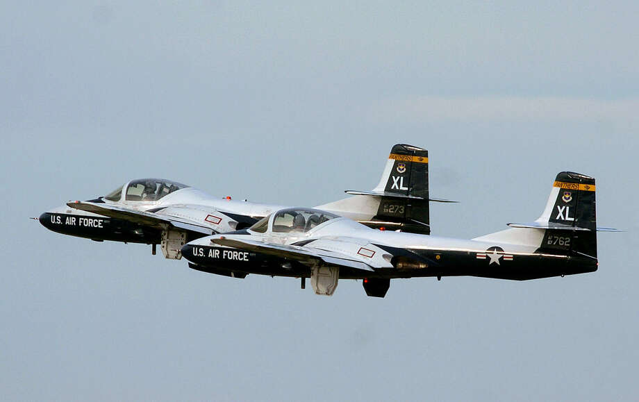Laughlin Air Force Base in Del Rio has long been a pilot training hub for the service. This 2004 file photo shows a flight of T-37 jet trainers taking off during a retirement ceremony for the aircraft type, which had been in service since the 1950s. Photo: BILLY CALZADA /SAN ANTONIO EXPRESS-NEWS / SAN ANTONIO EXPRESS-NEWS