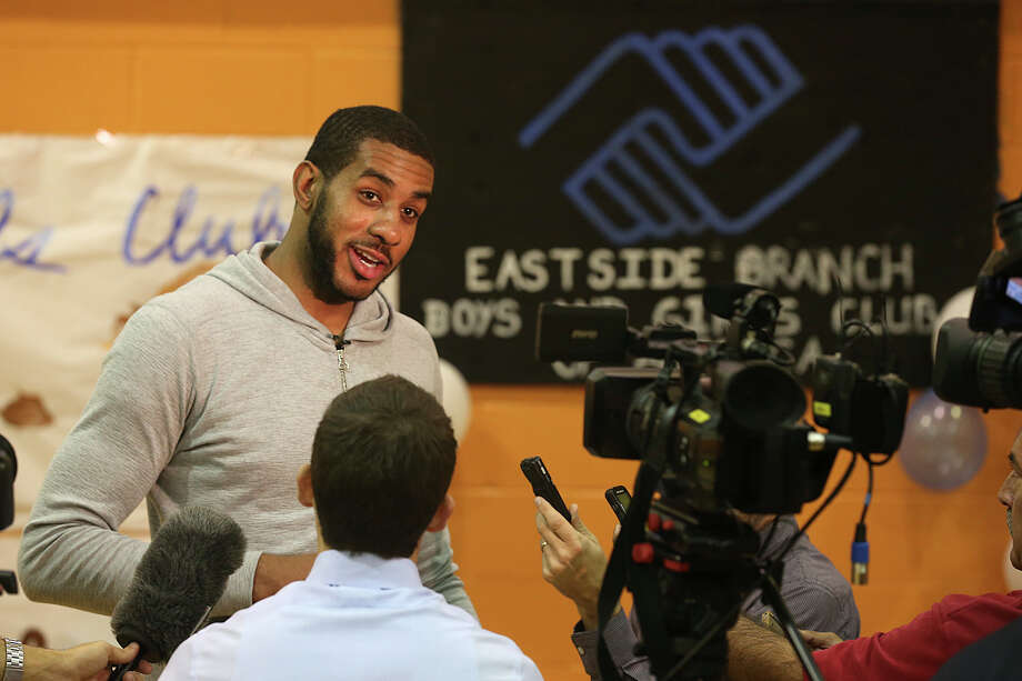 Spurs forward LaMarcus Aldridge talks with media at the Boys & Girls of San Antonio East Side branch on Nov. 15, 2015. Aldridge teamed up with H-E-B to give 200 Boys and Girls Club families a Thanksgiving dinner of turkey and trimmings. The families were also treated to Thanksgiving prep party that included arts & crafts and participating in a recipe demonstration. Photo: Jerry Lara /San Antonio Express-News / © 2015 San Antonio Express-News