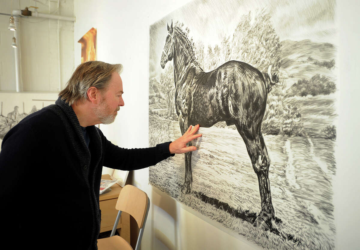 Fairfield artist Rick Shaefer discusses his charcoal drawings during the annual Bridgeport Art Trail Open Studios at the NEST arts factory at 1720 Fairfield Avenue in Bridgeport, Conn. on Sunday, November 15, 2015. The annual Art Trail weekend allows art lovers and the curious to visit artist studios at a variety of locations across the city.