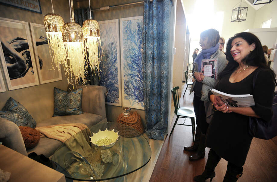 """Kirsten Etela, left, and Lisa Rolleri, both of Fairfield, check out """"The Diving Room"""", designed by Tracy Dwyer and Patrick Briel, at the annual Rooms with a View interior design showcase at the Southport Congregational Church in Fairfield, Conn. on Sunday, November 15, 2015. Rooms this year were designed around the theme """"I'll Be Home for Christmas"""". Photo: Brian A. Pounds, Hearst Connecticut Media / Connecticut Post"""
