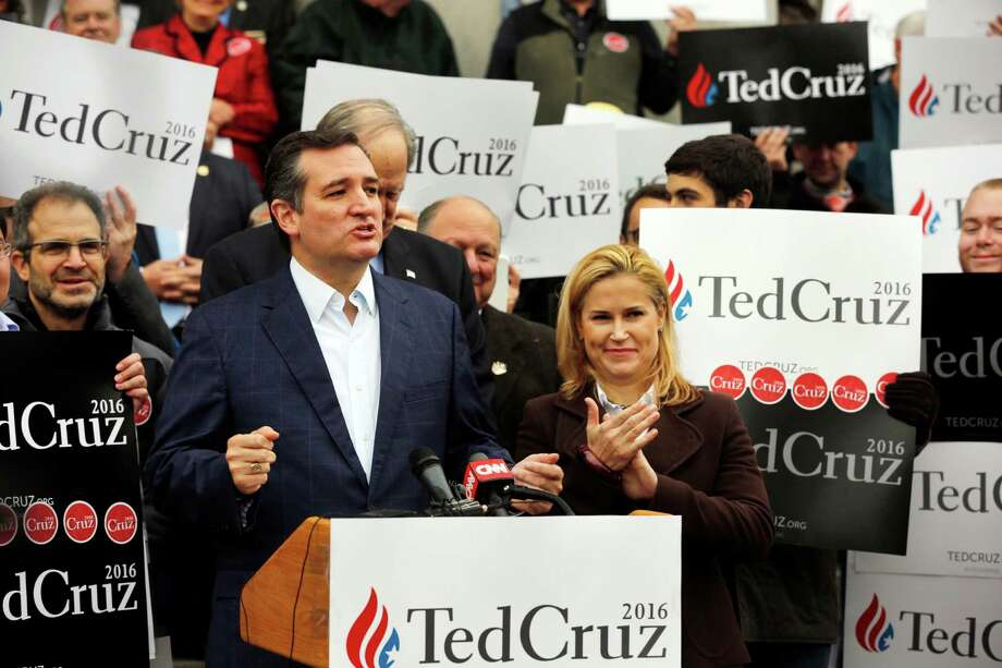 Republican presidential candidate Sen. Ted Cruz, R-Texas, with his wife Heidi, talks to supporters after filing papers to be on the Nation's earliest presidential primary ballot at The Secretary of State's Office recently in Concord, N.H. Photo: Jim Cole /Associated Press / AP