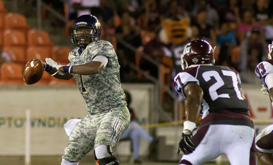 HIGHSAround the area:Prairie View A&M notched its sixth consecutive victory, as dynamic quarterback Trey Green threw for 299 yards in the Panthers' 38-13 triumph at Alabama State. Prairie View, 7-1 in league play, owns the second best conference record in the SWAC behind Grambling State (8-0). Photo: Jerry Baker, For The Houston Chronicle