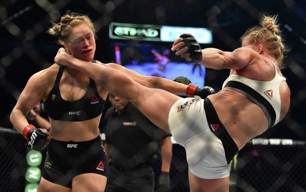 Ain't that a kick in the head? Holly Holm, right, lands the blow that dealt Rhonda Rousey her first defeat.