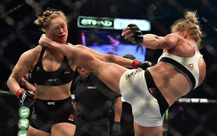 Ain't that a kick in the head? Holly Holm, right, lands the blow that dealt Rhonda Rousey her first defeat. Photo: PAUL CROCK, Stringer / AFP