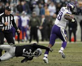 Neiko Thorpe (31) misses a tackle on Adrian Peterson (28) allowing Peterson to run for 80 yards and a touchdown in the second half as the Raiders played the Minnesota Vikings at O.co Coliseum in Oakland, Calif., on Sunday, November 15, 2015. The Vikings defeated the Raiders 30-14.