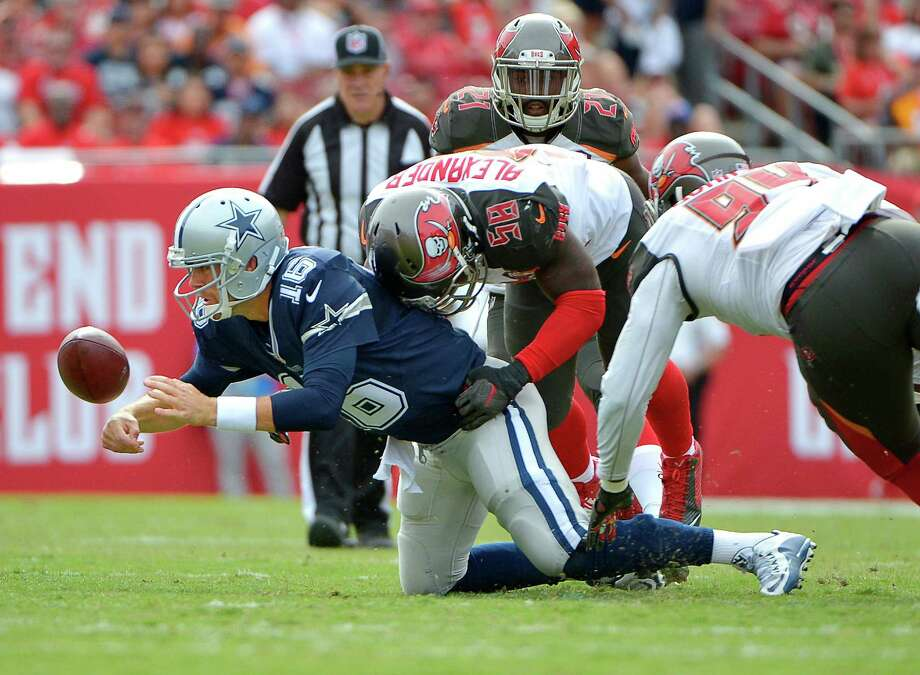 Dallas Cowboys quarterback Matt Cassel (16) fumbles and recovers the ball during the first quarter on Sunday, Nov. 15, 2015, at Raymond James Stadium in Tampa, Fla. (Max Faulkner/Fort Worth Star-Telegram/TNS) Photo: Max Faulkner, MBR / McClatchy-Tribune News Service / Fort Worth Star-Telegram