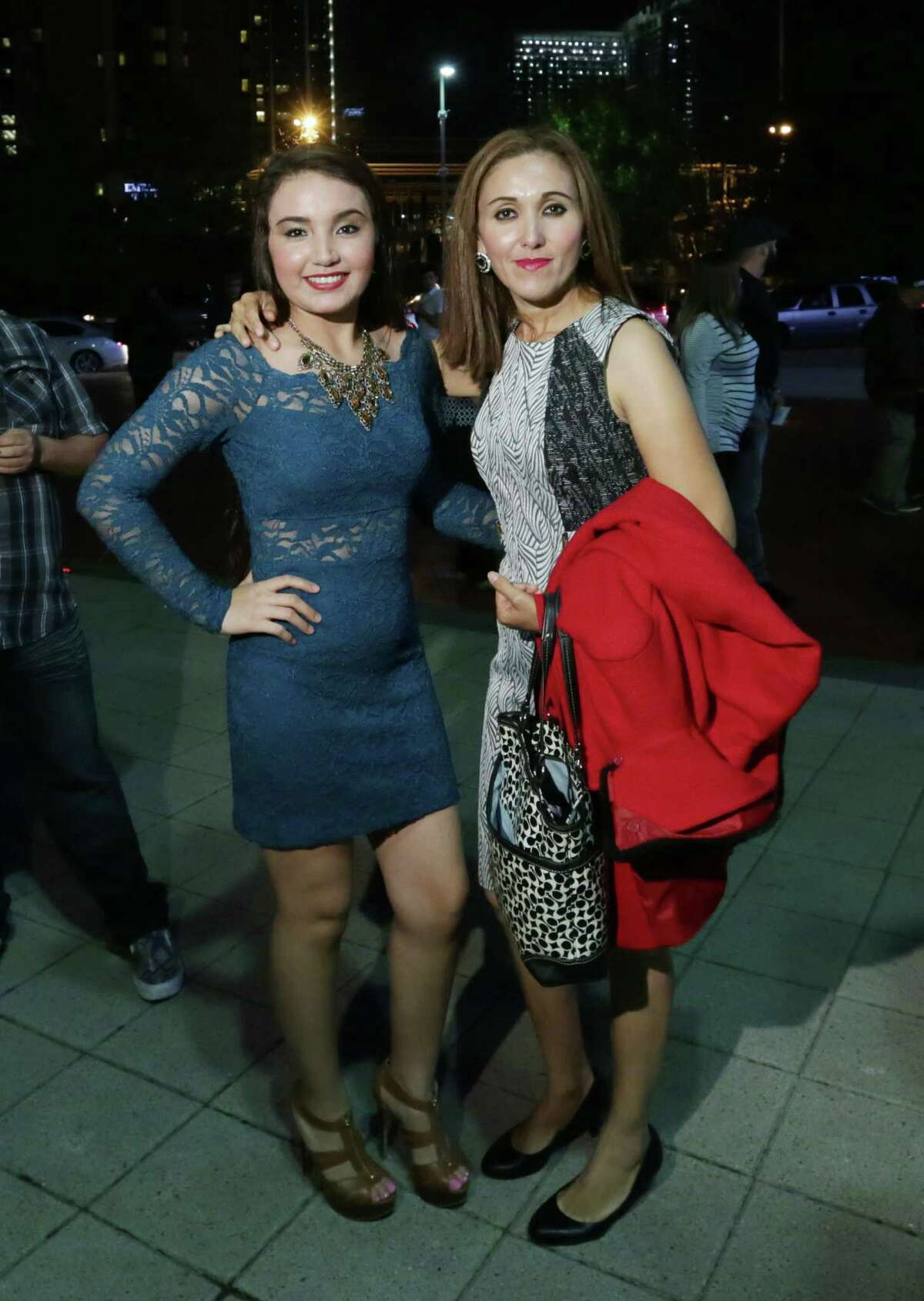 People pose for a photo before a Juan Gabriel concert at the Toyota Center Sunday, Nov. 15, 2015, in Houston.