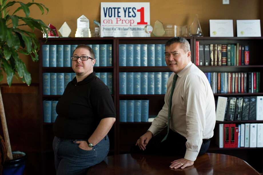 H.C. Bailey, left, works at a law office with attorney John Nechman, a Korean immigrant who fought his way through adolescence in 1970s Houston as a gay Asian in an America still licking its Vietnam War wounds.  Photo: Marie D. De Jesus, Staff / © 2015 Houston Chronicle