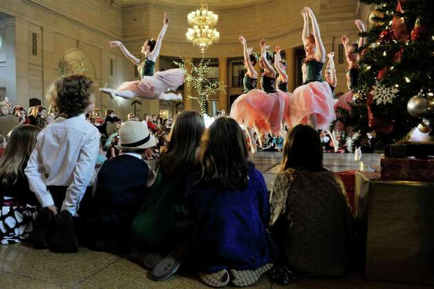 Children watch from close up as members of the Northeast Ballet Company perform during the Saratoga Performing Arts Center's Annual Nutcracker Tea on Sunday, Nov. 15, 2015, in Saratoga Springs, N.Y.  The ballet company took part in three performances on Sunday.  The Northeast Ballet Company will perform the full Nutcracker Ballet at Proctors Theater on December 4th, 5th, and 6th.  (Paul Buckowski / Times Union) Photo: PAUL BUCKOWSKI / 00034234A