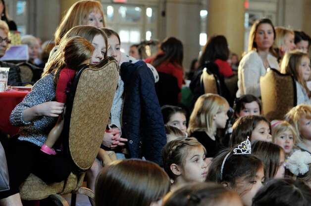 Children and adults watch as members of the Northeast Ballet Company perform during the Saratoga Performing Arts Center's Annual Nutcracker Tea on Sunday, Nov. 15, 2015, in Saratoga Springs, N.Y.  The ballet company took part in three performances on Sunday.  The Northeast Ballet Company will perform the full Nutcracker Ballet at Proctors Theater on December 4th, 5th, and 6th.  (Paul Buckowski / Times Union) Photo: PAUL BUCKOWSKI / 00034234A
