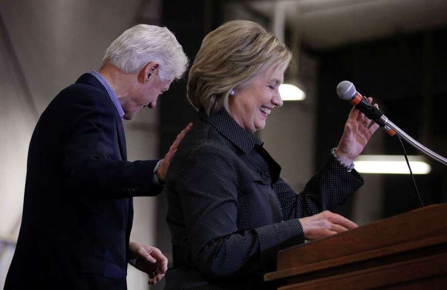 Presidential candidate Hillary Clinton and former President Bill Clinton attend the Central Iowa Democrats fall barbecue in Ames. Photo: Alex Wong /Getty Images / 2015 Getty Images
