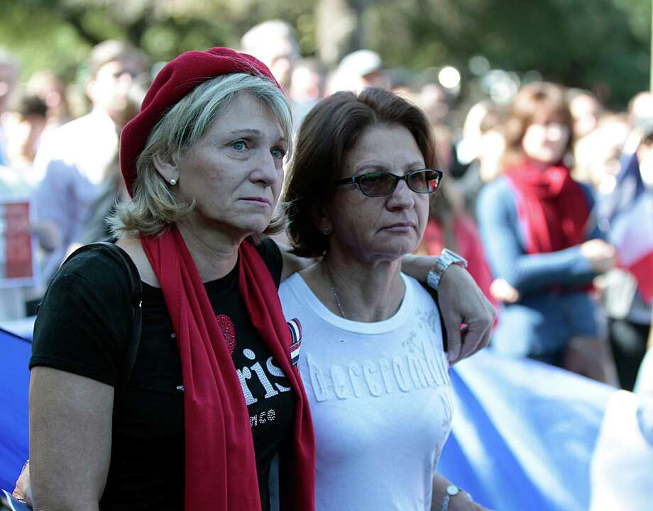 Veronique Moore left, and Francoise Burtz right, during the  Houston Home and Houston-Nice sister city moment of contemplation at Sam Houston Park mourning the the victims of Friday's attacks in Paris Sunday, Nov. 15, 2015, in Houston. Photo: James Nielsen, Houston Chronicle / © 2015  Houston Chronicle