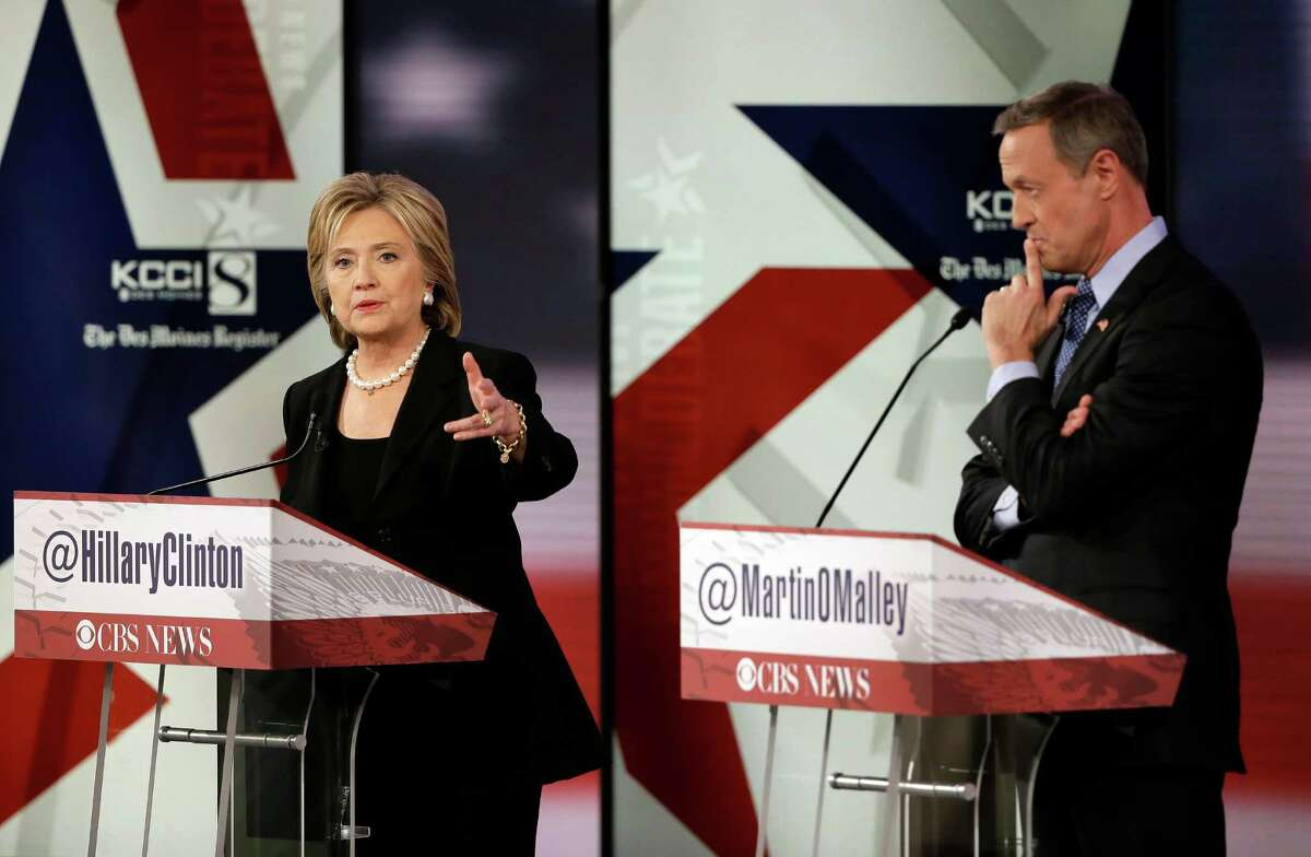 Hillary Rodham Clinton makes a point as Martin O'Malley listens during a Democratic presidential primary debate, Saturday, Nov. 14, 2015, in Des Moines, Iowa. (AP Photo/Charlie Neibergall) ORG XMIT: IAKS140